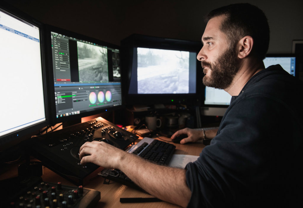 Man Using Multiple Screens