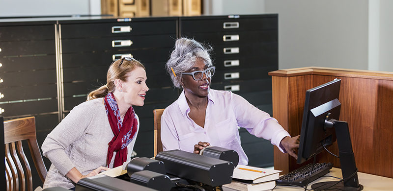 Staff working in library and archive